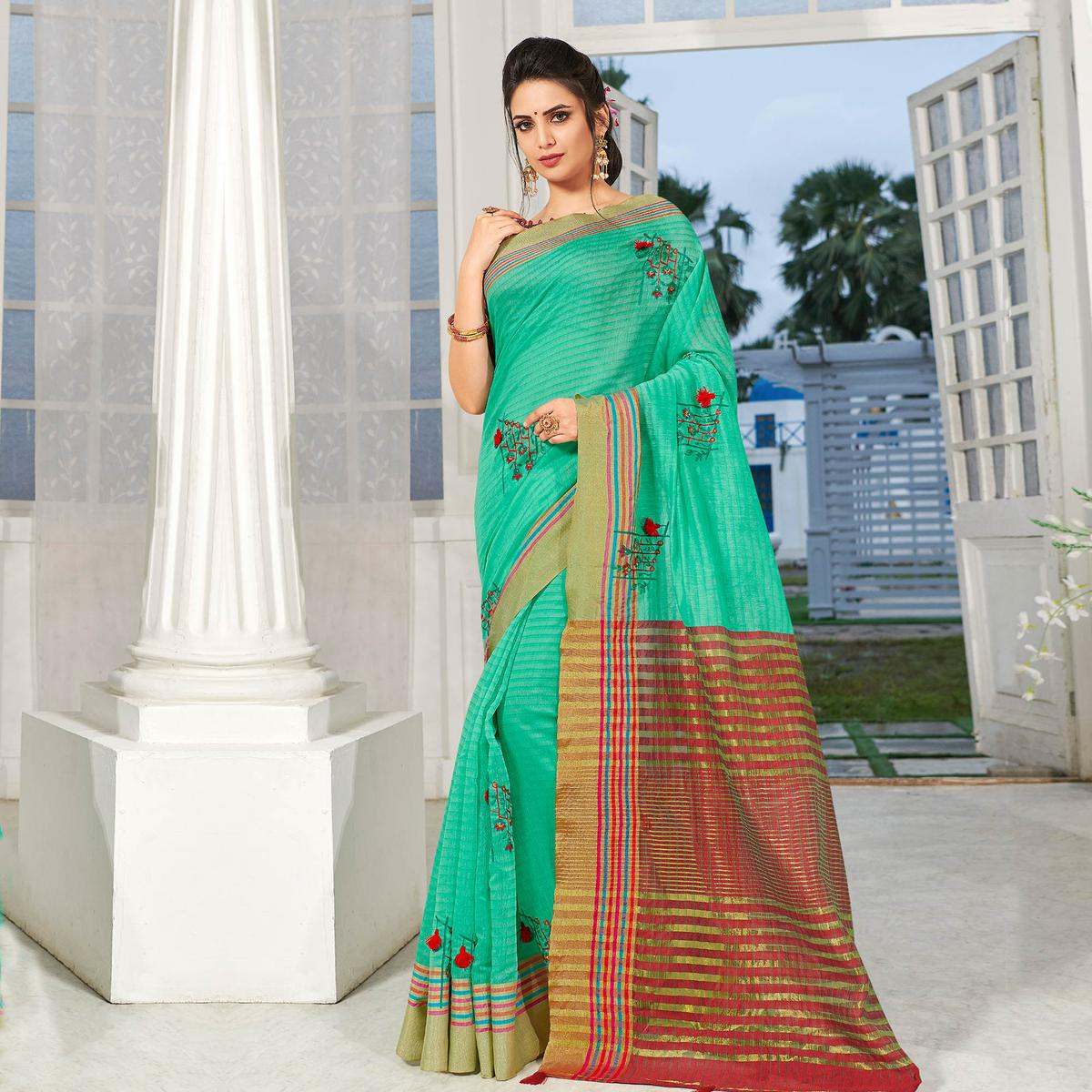 Radiant Turquoise Colored Party Wear Embroidered Cotton Silk Saree With Tassels