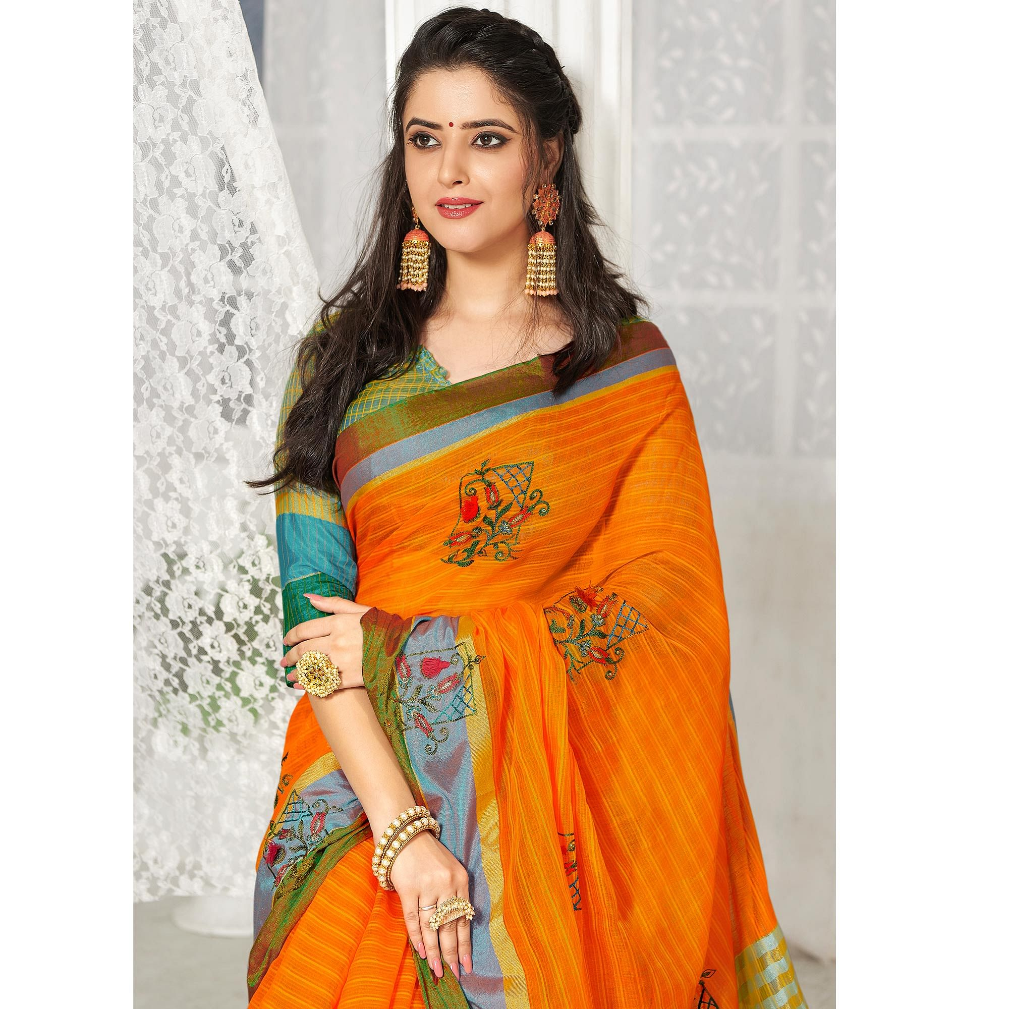 Gleaming Orange Colored Party Wear Embroidered Cotton Silk Saree With Tassels
