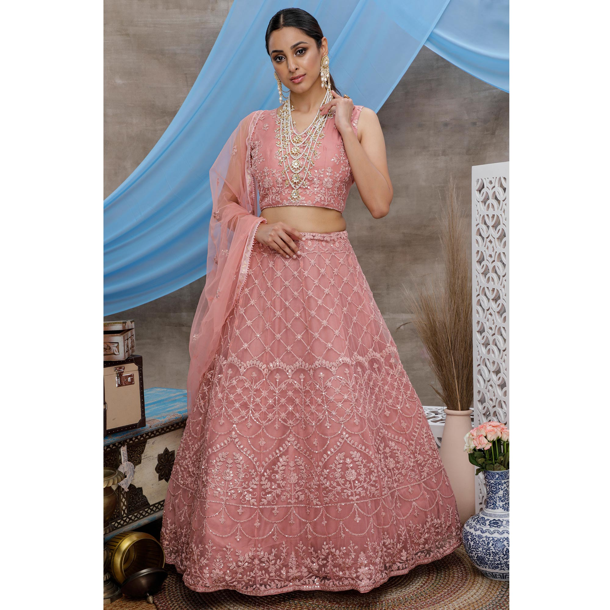 Jazzy Pink Colored Party Wear Heavy Embroidered Net Lehenga Choli