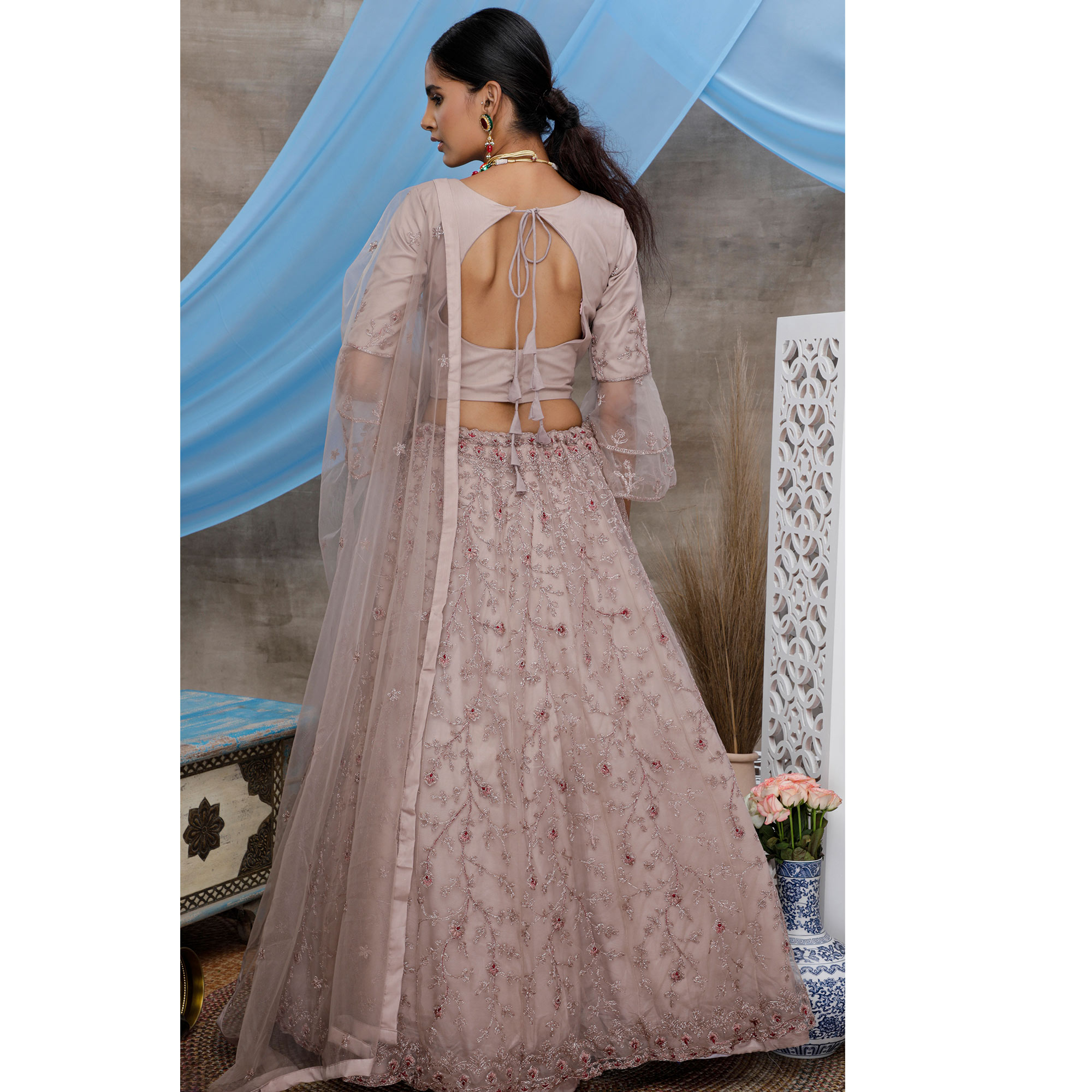 Engrossing Dusty Purple Colored Party Wear Heavy Embroidered Net Lehenga Choli