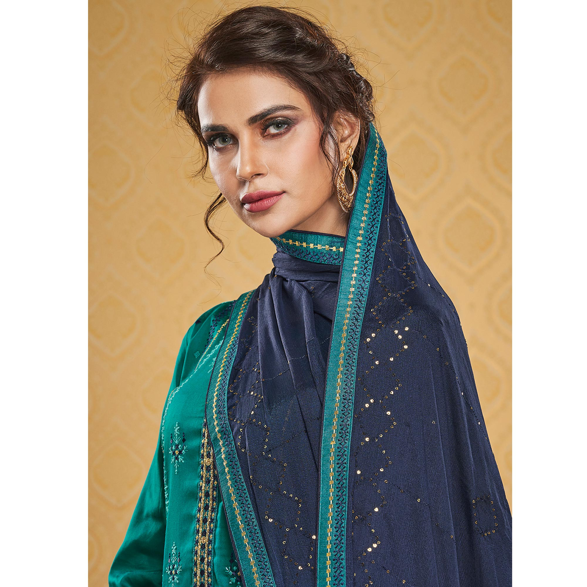 Attractive Teal Blue Colored Designer Partywear Embroidered Jam Silk Palazzo Suit