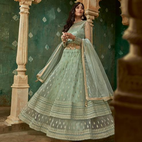 Lovely Light Green Colored Designer Partywear Embroidered Net Anarkali Suit