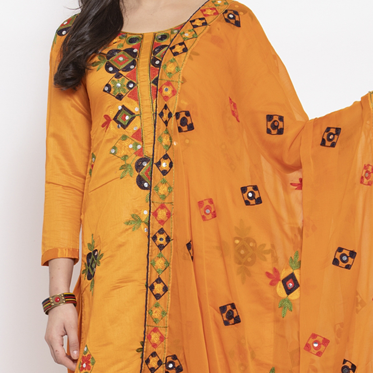 Demanding Orange Colored Party Wear Embroidered Chanderi Silk Dress Material