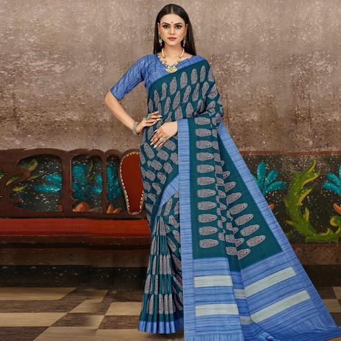 Glowing Teal Blue Colored Partywear Floral Printed Silk Saree