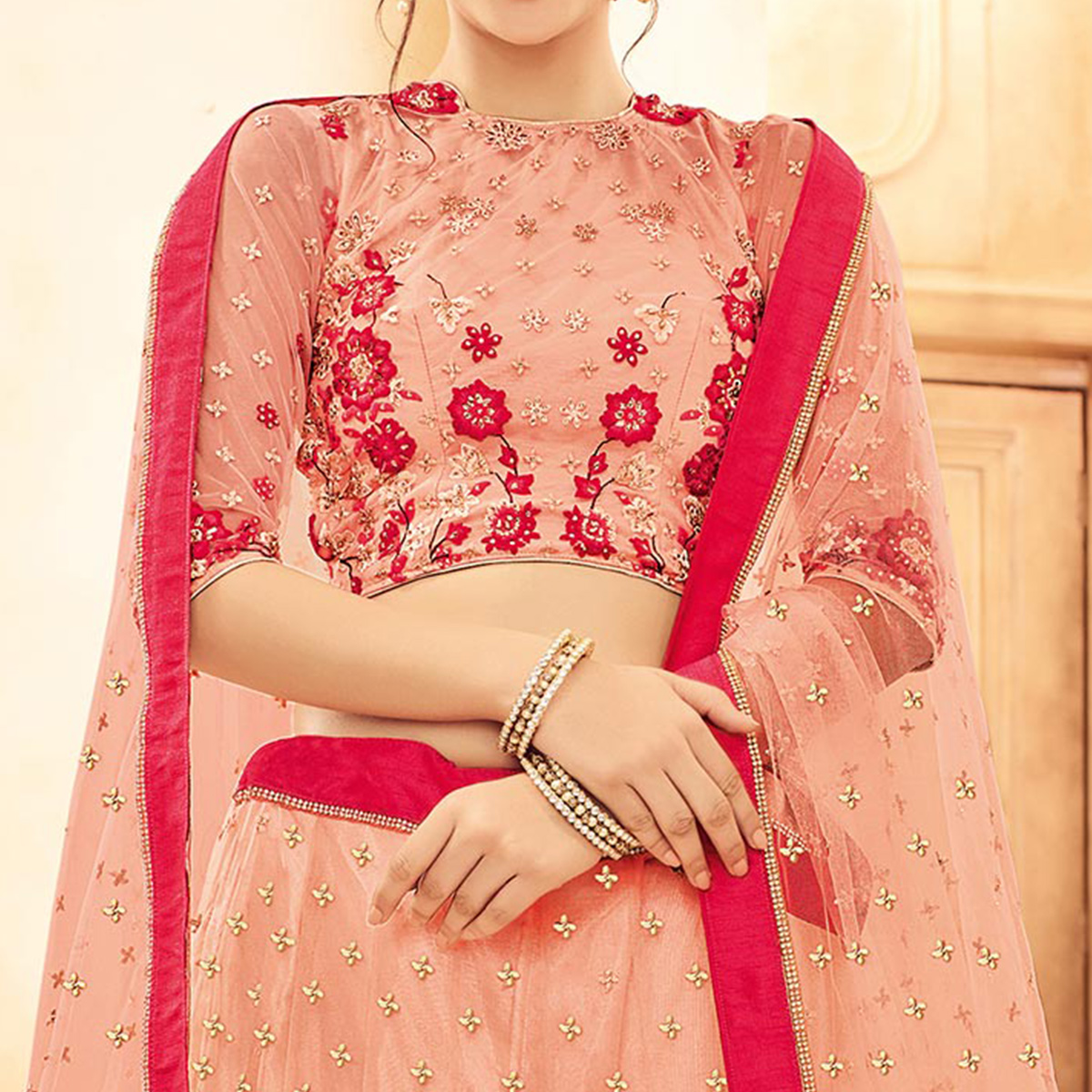Delightful Peach-Pink Designer Embroidered Butterfly Net Lehenga Choli