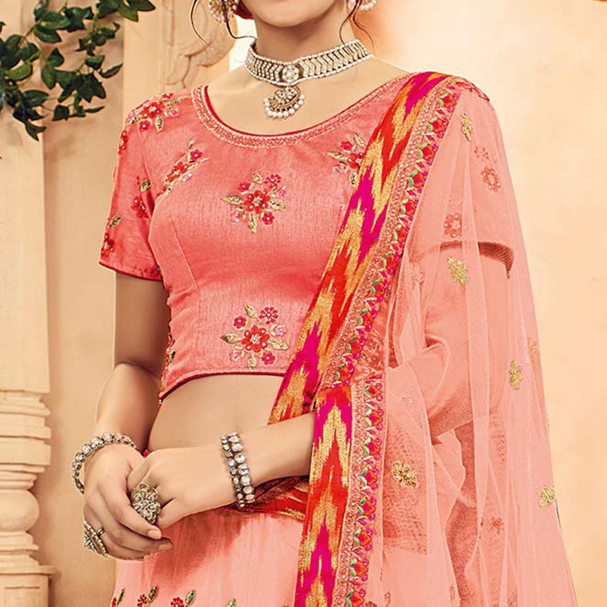 Sizzling Peach-Pink Designer Embroidered Butterfly Net Lehenga Choli