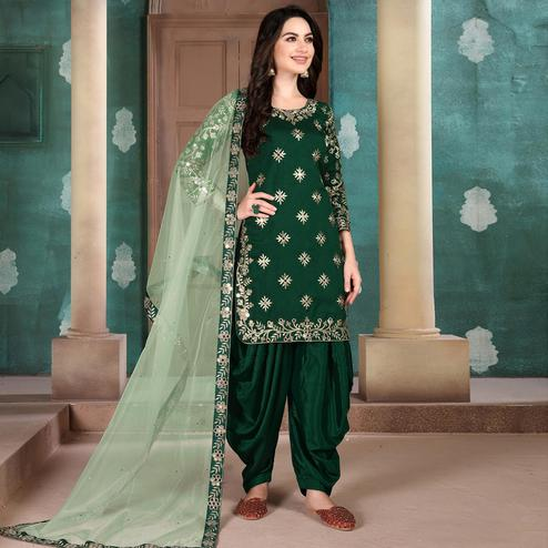 Flattering Green Colored Designer Partywear Embroidered Heavy Art Silk Patiala Suit