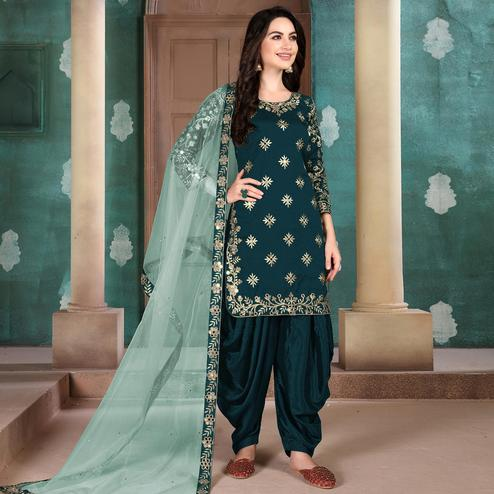 Preferable Rama Colored Designer Partywear Embroidered Heavy Art Silk Patiala Suit