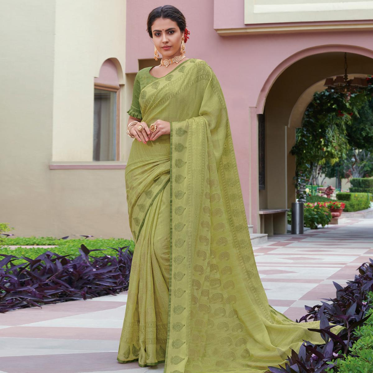Blissful Pista Green Colored Festive Wear Foil Brasso Saree