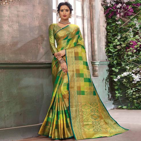 Charming Green Colored Festive Wear Check Woven Banarasi Silk Saree