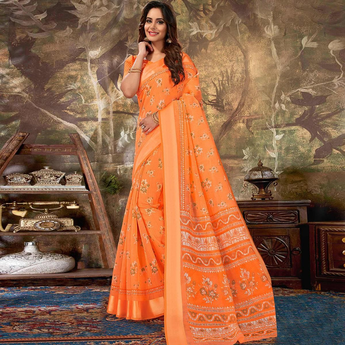 Adorning Orange Colored Casual Wear Floral Printed Cotton Saree