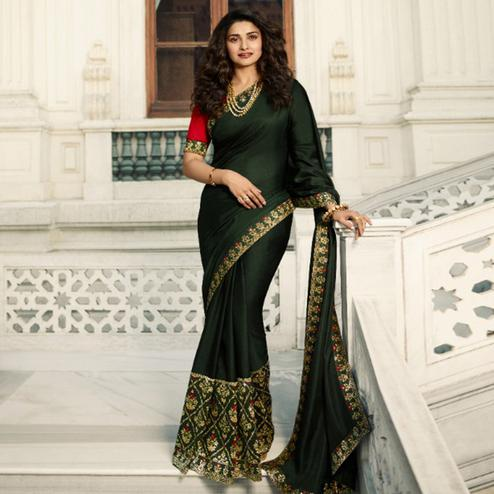 Mesmerising Mehendi Green Colored Partywear Solid Vichitra Silk Saree