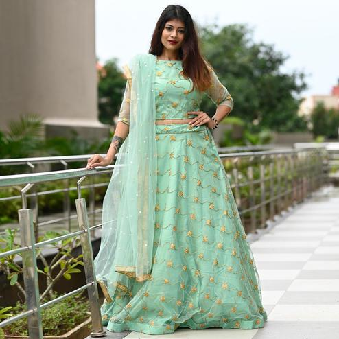 Blissful Pista Green Colored Partywear Embroidered Net Gown