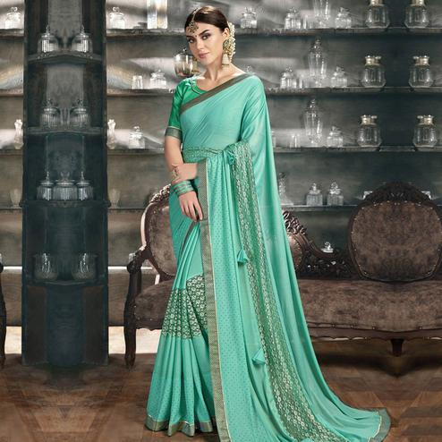 Graceful Turquoise Colored Party Wear Lycra Saree