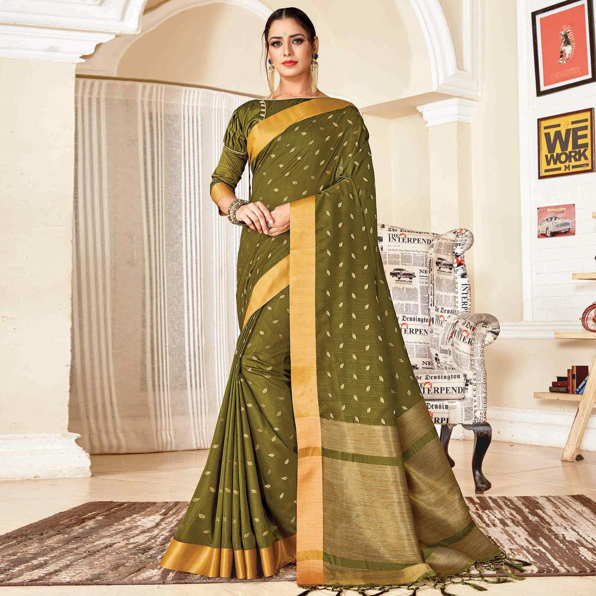 Jazzy Olive Green Colored Festive Wear Woven Handloom Silk Saree With Tassels