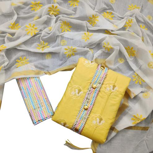Amazing Yellow Colored Partywear Embroidered Cotton Dress Material