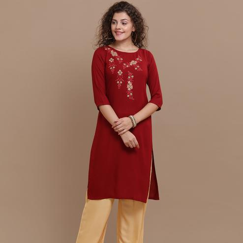 Classy Maroon Colored Partywear Floral Embroidered Rayon Kurti