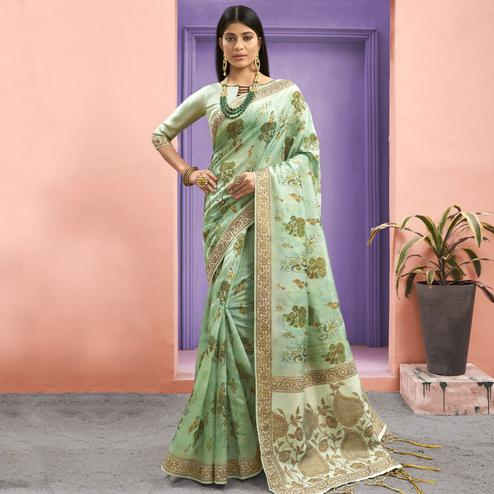 Magnetic Green Colored Festive Wear Woven Jacquard Silk Saree With Tassels