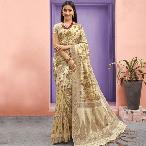 Hypnotic Cream Colored Festive Wear Woven Jacquard Silk Saree With Tassels