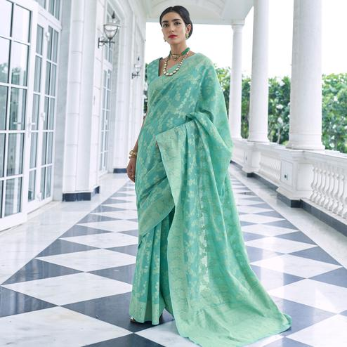 Sensational Green Colored Festive Wear Woven Chanderi Saree