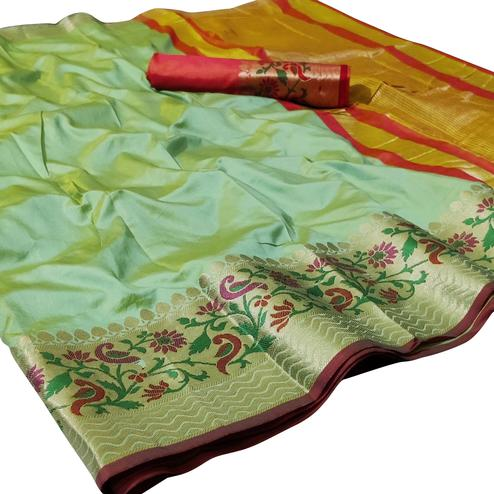 Blissful Pista Green Colored Festive Wear Woven Silk Saree