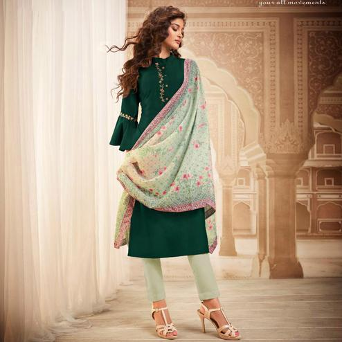 Unique Green Colored Partywear Embroidered Heavy Muslin Salwar Suit