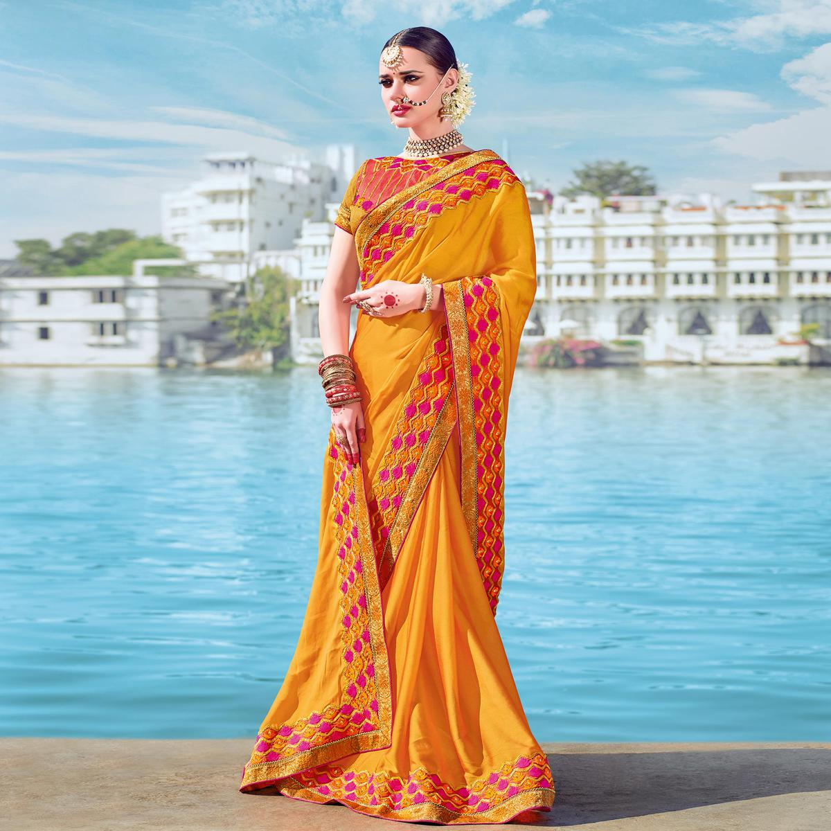 Ravishing Yellow Designer Embroidered Georgette Saree