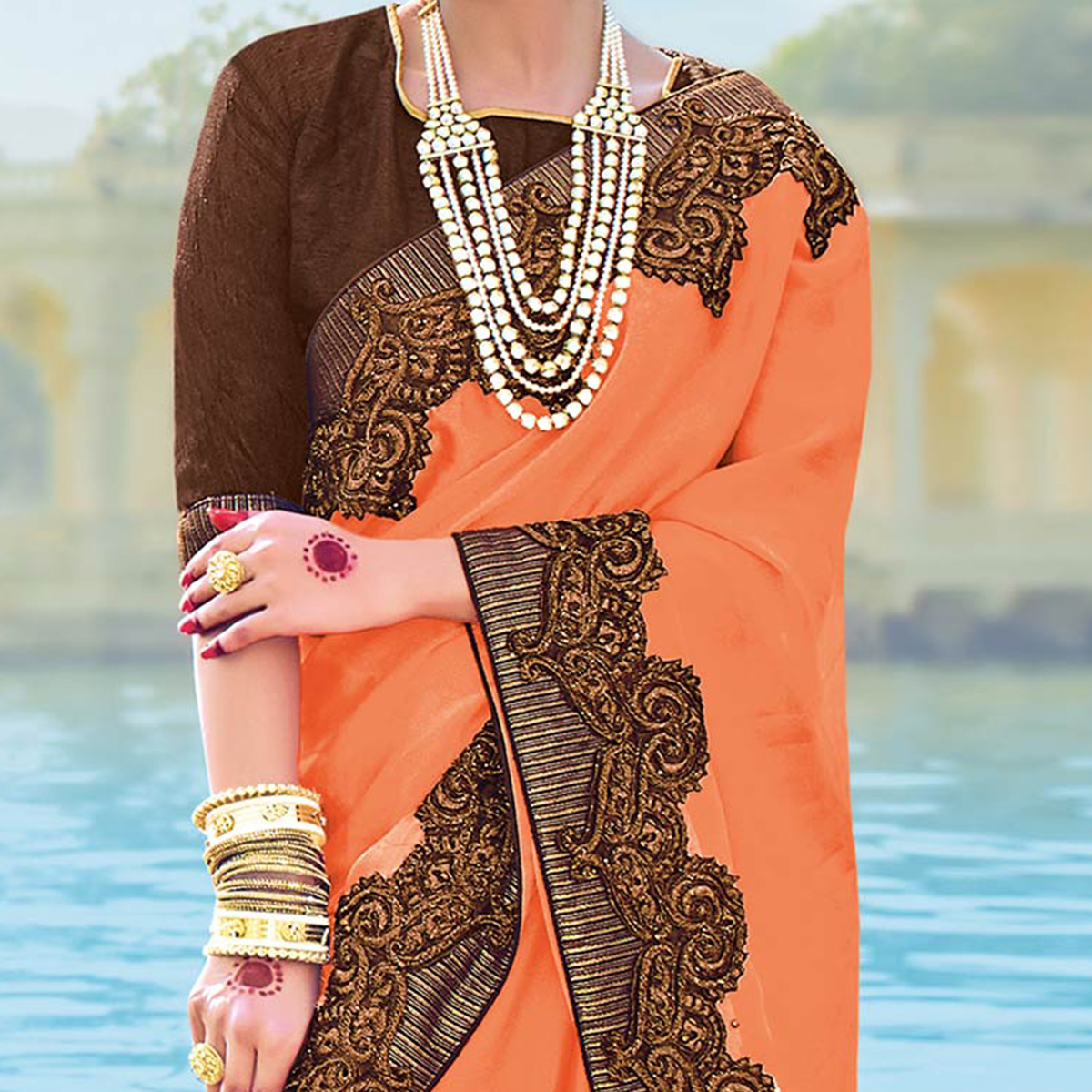 Lovely Orange Colored Designer Embroidered Georgette Saree