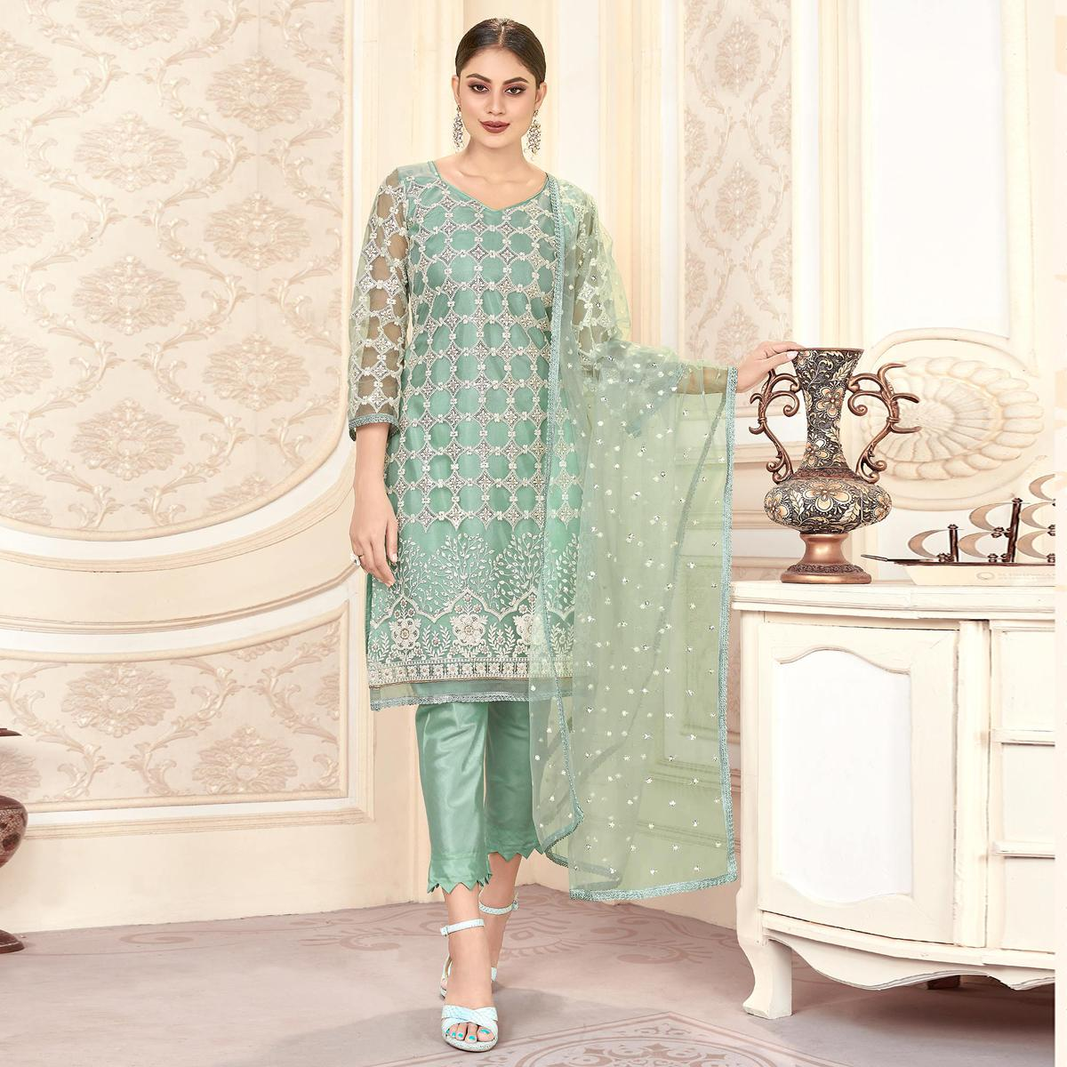 Innovative Pastel Green Colored Partywear Embroidered Net Dress Material