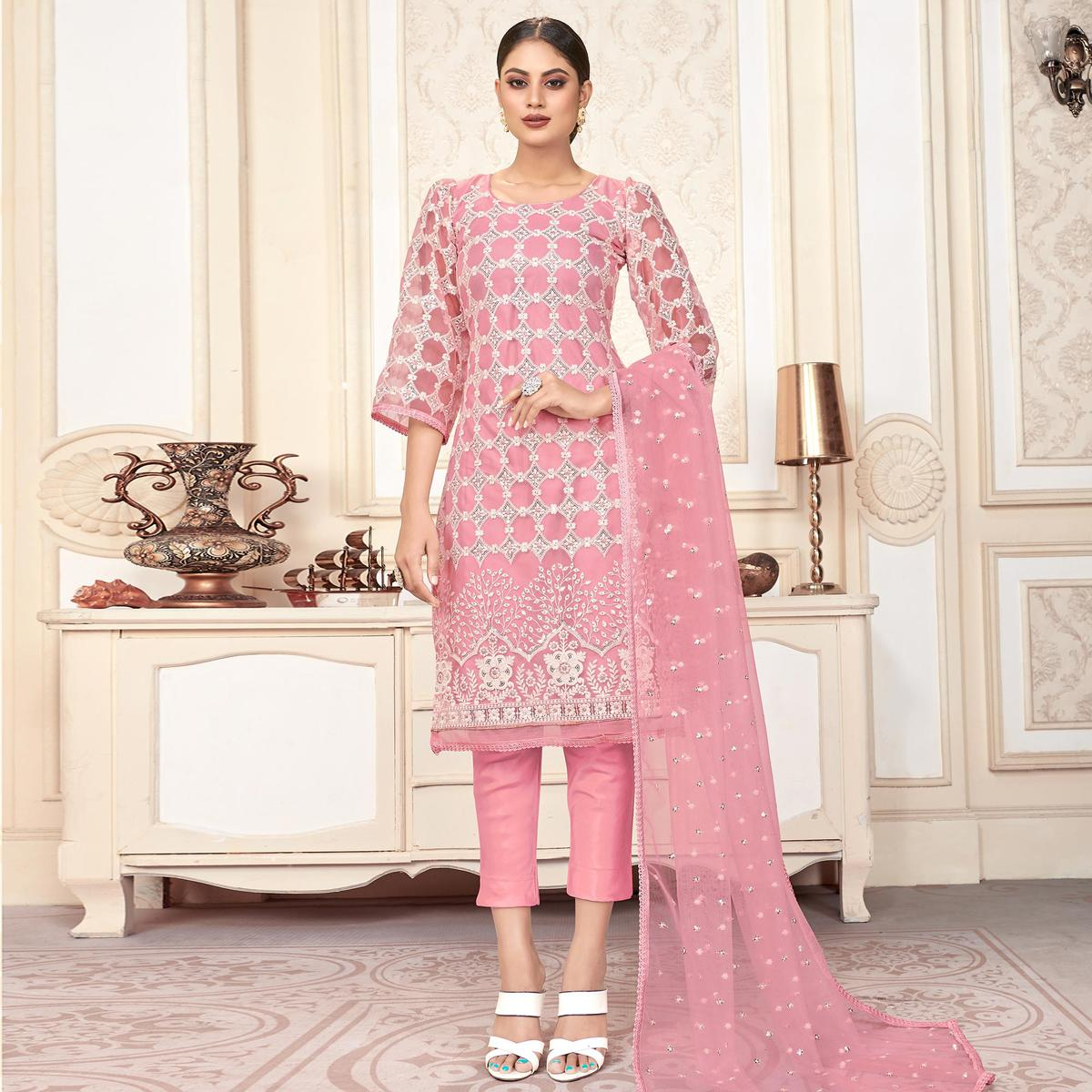 Eye-catching Pink Colored Partywear Embroidered Net Dress Material