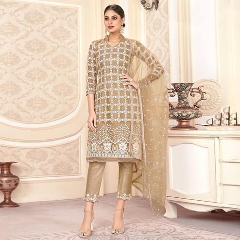 Fantastic Beige Colored Partywear Embroidered Net Dress Material