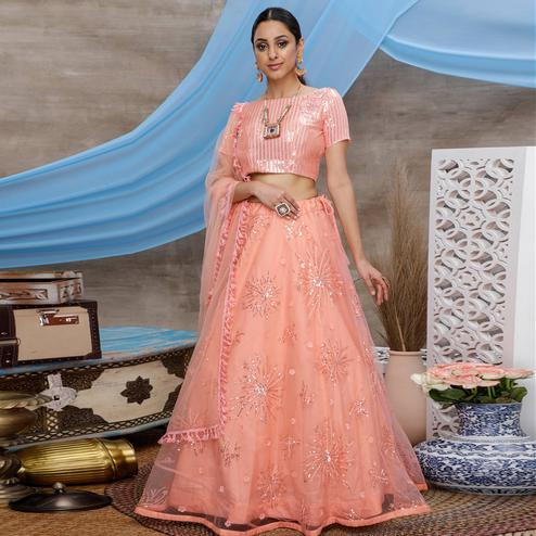 Excellent Orange Colored Designer Partywear Embroidered Net Lehenga Choli