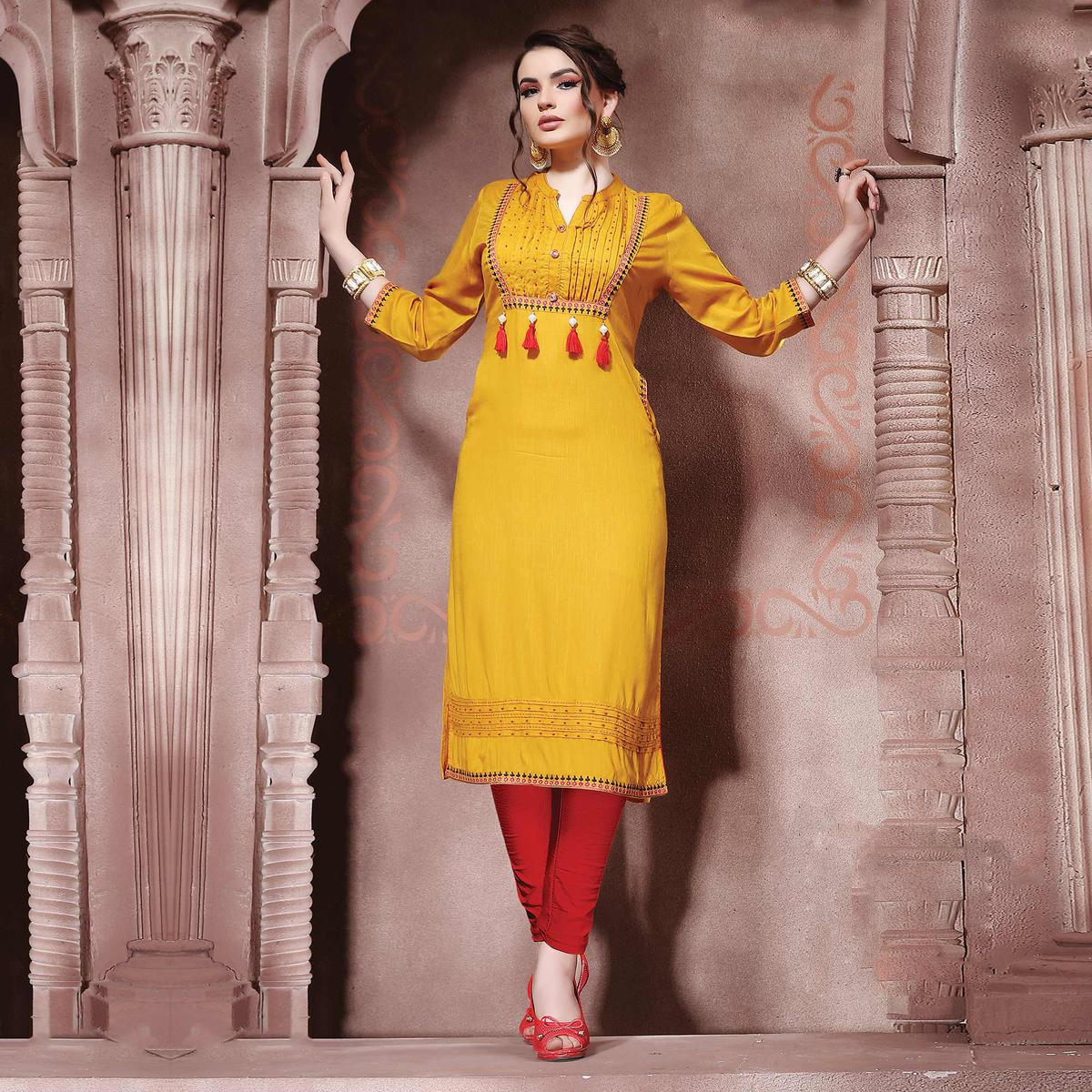 Charming Yellow Designer Embroidered Cotton Kurti