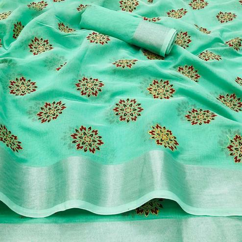 Gorgeous Rama Green Colored Festive Wear Printed Linen Saree