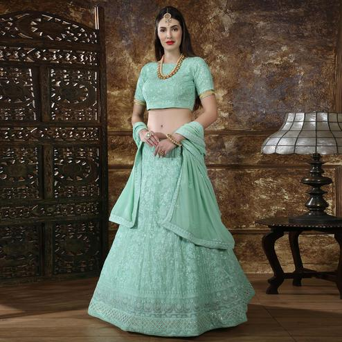 Amazing Mint Green Colored Partywear Embroidered Gerogette Lehenga Choli