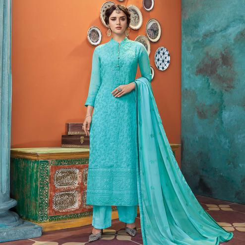 Preferable Aqua Blue Colored Partywear Embroidered Heavy Faux Georgette Palazzo Suit