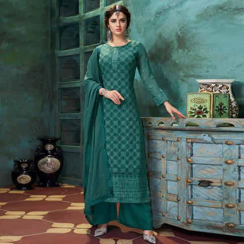 Flamboyant Dark Green Colored Partywear Embroidered Heavy Faux Georgette Palazzo Suit