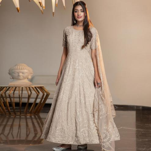 Beautiful Beige Colored Partywear Embroidered Georgette Anarkali Suit