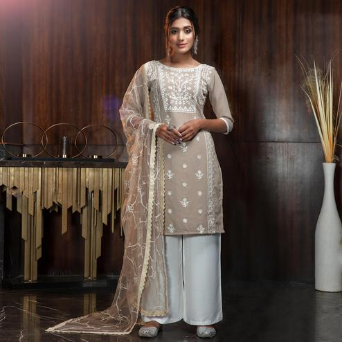 Delightful Beige Colored Partywear Embroidered Gerogette Palazzo Suit
