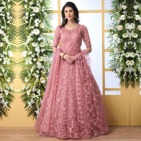 Unique Dusty Peach Colored Party Wear Embroidered Net Gown With Dupatta