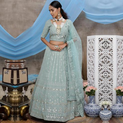 Radiant Dusty Green Colored Party Wear Embroidered Georgette Lehenga Choli