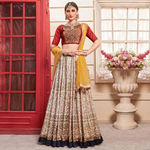 Demanding Beige Colored Party Wear Foil Print Phantom Art Silk Lehenga Choli