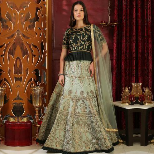 Exclusive Light Green Colored Party Wear Foil Print Silk Lehenga Choli