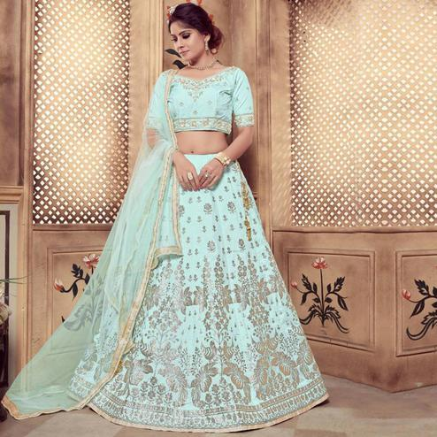 Staring Turquoise Blue Colored Party Wear Embroidered Silk Lehenga Choli