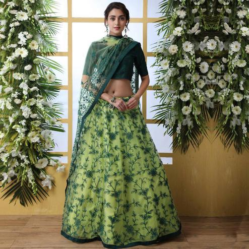 Glorious Green Colored Party Wear Embrodiered Net Lehenga Choli