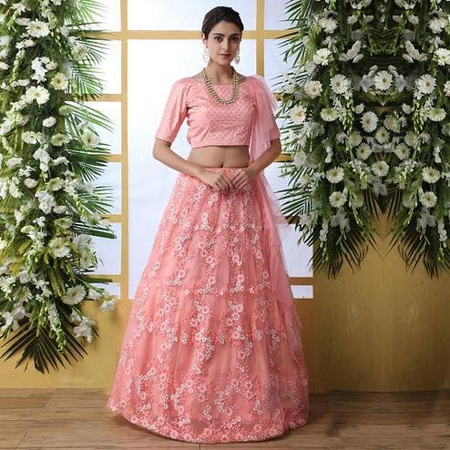 Attractive PeachColored Party Wear Embrodiered Net Lehenga Choli