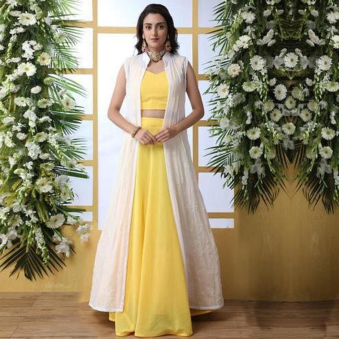 Prominent Yellow Colored Party Wear Solid Georgette Lehenga Choli With Koti