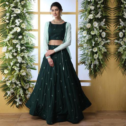 Entrancing Dark Green Colored Party Wear Embroidered Muslin Cotton Lehenga Choli With Koti