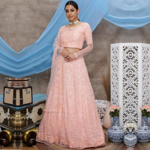 Intricate Peach Colored Party Wear Embroidered Net Lehenga Choli