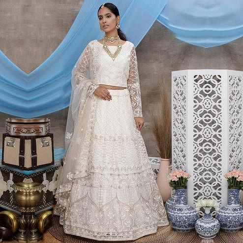 Arresting White Colored Party Wear Embroidered Net Lehenga Choli